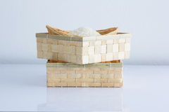 Raw and uncooked rice in basket weave. Stock Photography