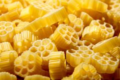 Free Raw Uncooked Rotelle Dry Italian Pasta. Ruote, Wagon Wheel Shape Stock Images - 122348394