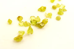 Raw uncut Peridot gem stones, white background Royalty Free Stock Images