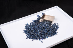 Raw, uncut and rough blue Sapphire crystals. Royalty Free Stock Image