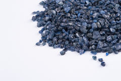 Raw, uncut and rough blue Sapphire crystals. Stock Images