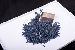 Raw, uncut and rough blue Sapphire crystals. Royalty Free Stock Photography