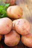 Raw unpeeled potatoes Royalty Free Stock Images