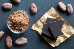 Raw unroasted cocoa powder, raw cacao nibs and chocolate Royalty Free Stock Photos