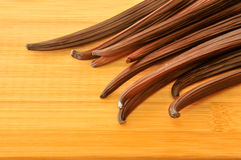 Raw vanilla bean on the top of wooden board Stock Photos