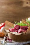 Raw veal cut into pieces with vegetables and other ingredients Stock Images