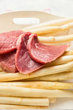 Raw veal meat with white asparagus Royalty Free Stock Images