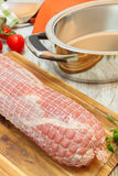 Raw veal roulade. ready to barbecue. Raw veal roulade with bacon, ham , vegetables  and spices on wooden board  ready to barbecue. Preparing food Stock Photo