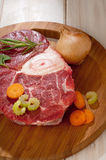Raw veal shank with ingredients Stock Photo