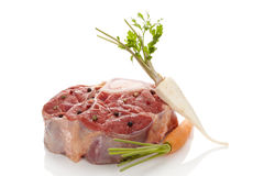 Raw veal shank meat with vegetables. Raw veal shank meat with vegetables on white. Ossobucco steak eating Royalty Free Stock Photo