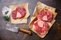 Raw veal shank and seasonings for making Osso Buco Royalty Free Stock Images
