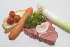 Raw veal shank with soup  vegetables. Essential ingredients for the Italian national dish Osso Bucco Stock Images