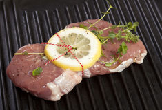 Raw Veal Steak with Lemon and Thyme Stock Photography