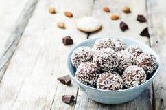 Raw vegan almond butter coconut chocolate balls. Toning. selective focus Stock Photos