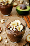 Raw vegan avocado banana chocolate pudding Stock Photo