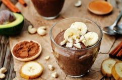 Raw vegan avocado banana chocolate pudding. The toning. selective focus stock images