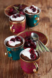Raw vegan avocado chocolate mousse with cherries. And coconut whipped cream Stock Image