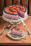 Raw vegan berry cheesecake. With a slice served on a plate royalty free stock images
