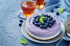 Raw vegan Blueberry Cashews cake. On a stone background. toning. selective focus royalty free stock photo