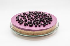 Raw vegan cake with blueberries. Thia is a raw vegan cake without sugar. Instead he have honey. Complet recipe contains figs, caju, blueberries, coconut, bananas Stock Image