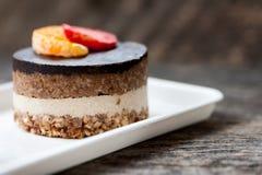 Raw vegan cake. With chocolate on top royalty free stock photo