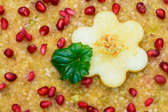 Raw vegan cake decorated with nice colored full fruits, nuts, flower seeds and natural organic ingredients. Healthy and yet tasty Stock Photography
