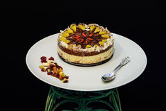 Raw vegan cake decorated with nice colored full fruits, nuts, flower seeds and natural organic ingredients. Healthy and yet tasty Royalty Free Stock Images