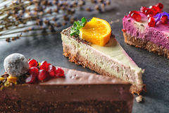 Raw vegan cakes with fruit and seeds, decorated with flower, product photography for patisserie royalty free stock images