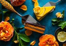 Raw vegan cakes. Raw vegan sweet cakes with mango,pineapple, buckthorn and nuts royalty free stock photos