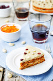 Raw vegan carrot cake with cashew cream and dried cranberries. Toning. selective focus stock image