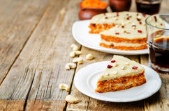 Raw vegan carrot cake with cashew cream and dried cranberries. Toning. selective focus royalty free stock photo