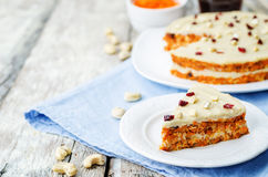 Raw vegan carrot cake with cashew cream and dried cranberries. Toning. selective focus royalty free stock images