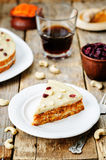 Raw vegan carrot cake with cashew cream and dried cranberries. Toning. selective focus royalty free stock image