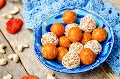 Raw vegan cashew dried apricots, coconut balls. Toning. selective focus stock photos