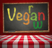 Raw vegan on chalkboard with Red Dining Table Royalty Free Stock Photo