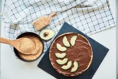 Raw vegan chocolate avocado and banana cake stock images