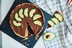 Raw vegan chocolate avocado and banana cake stock photo