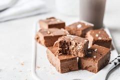 Raw vegan chocolate fudge on a white board. Healthy vegan food concept royalty free stock photo