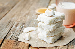 Raw vegan coconut bars. On a dark wood background. the toning. selective focus stock photography