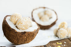 Raw Vegan Coconut and Lemon Truffles in the Coconut Shel Royalty Free Stock Photo