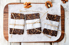 Raw vegan dates coconut walnut chocolate bars Royalty Free Stock Photography