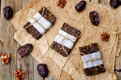Raw vegan dates coconut walnut chocolate bars Stock Photography