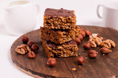 Raw vegan dates oats peanut butter bars with chocolate frosting Royalty Free Stock Image