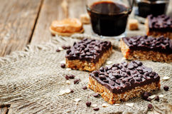 Raw vegan dates oats peanut butter bars with chocolate frosting Stock Photos