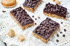 Raw vegan dates oats peanut butter bars with chocolate frosting Stock Photography
