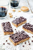 Raw vegan dates oats peanut butter bars with chocolate frosting Stock Photo