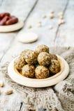 Raw vegan dates sesame pistachio balls Stock Photography