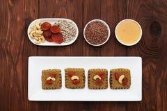 Raw vegan halvah and ingredients Stock Photos