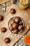 Raw vegan peanut butter oat coconut cacao balls. The toning. selective focus stock photos