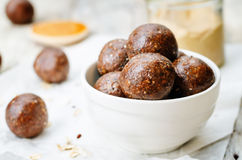 Raw vegan peanut butter oat coconut cacao balls. The toning. selective focus stock photo